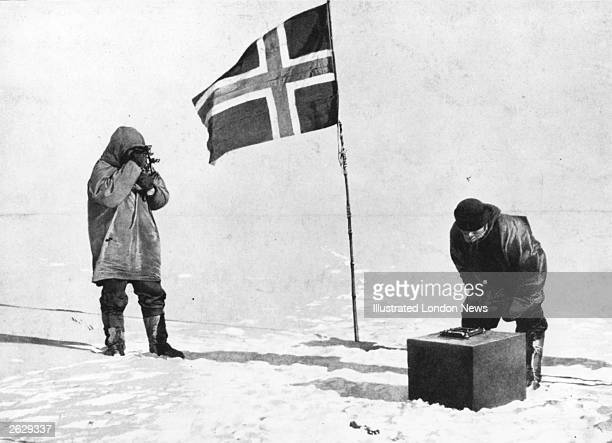 Norwegian explorer Captain Roald Amundsen taking sights at the South Pole beside the Norwegian flag