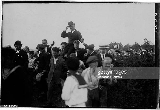 Norwegian explorer Roald Amundsen being borne shoulderhigh by the crowd 1900s