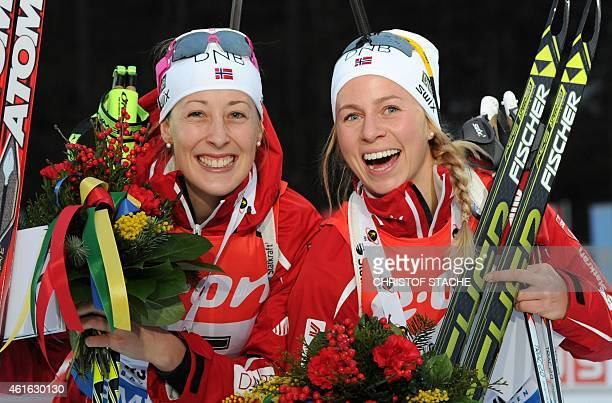 Norwegian Fanny WelleStrand Horn and her compatriot Norwegian Tiril Eckhoff celebrate after the winner ceremony of the women 75 kilometers sprint...