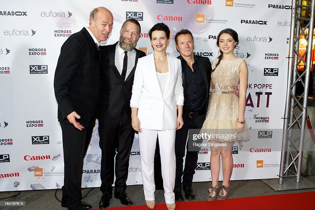 Norwegian film director Erik Poppe, actor Mads Ousdal, actress Juliette Binoche, U2 drummer Larry Mullen Jr and actress Lauryn Canny attend the Oslo premiere of 'A Thousand Times Good Night' at Colosseum on October 16, 2013 in Oslo, Norway.