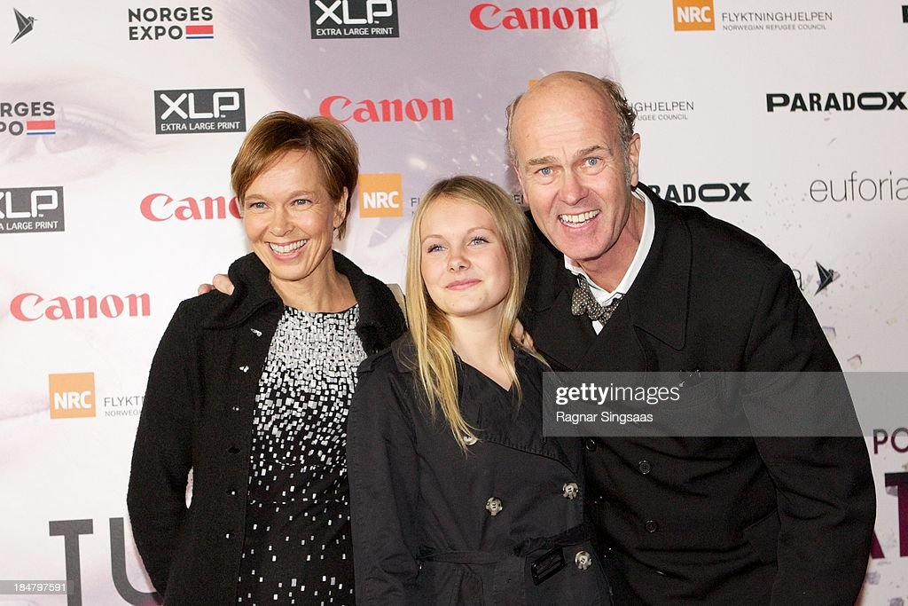 Norwegian film director Erik Poppe (R) arrives with his daughter Anna Leah (C) and wife Kirsten at the Oslo premiere of 'A Thousand Times Good Night' at Colosseum on October 16, 2013 in Oslo, Norway.