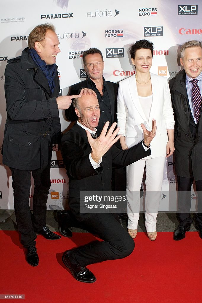 Norwegian film director Erik Poppe (front), U2 drummer Larry Mullen Jr (back row, center) and actress Juliette Binoche attend the Oslo premiere of 'A Thousand Times Good Night' at Colosseum on October 16, 2013 in Oslo, Norway.