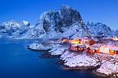 Traditional Norwegian fisherman's cabins, rorbuer, on the island of Hamnøy, Reine on the Lofoten in northern Norway. Photographed at dawn in winter.