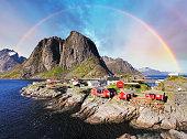 Norwegian fishing village huts with rainbow, Reine, Lofoten Islands, Norway