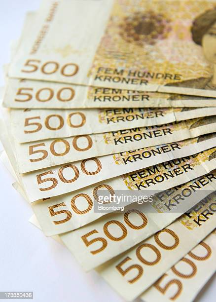 Norwegian five hundred krone currency notes sit in this arranged photograph in Oslo Norway on Friday July 13 2013 Norway's underlying inflation rate...