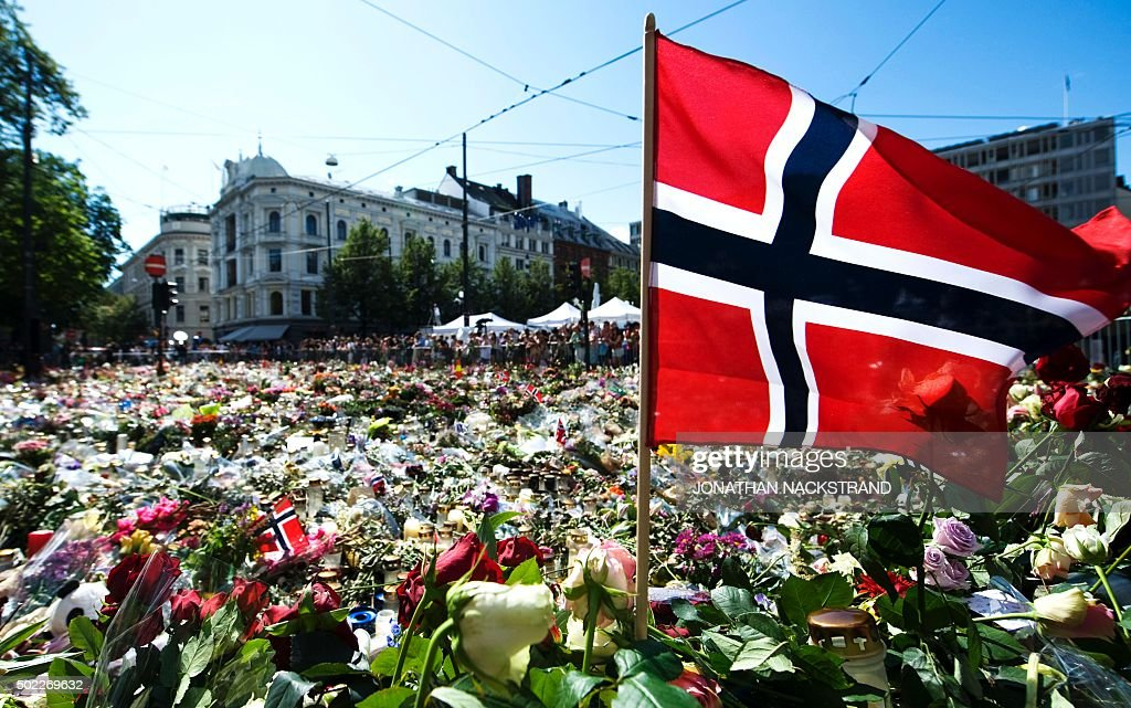 A Norwegian flag is placed at a makeshift memorial outside the Cathedral in Oslo in honor of the 76 victims of the July 22 twin attacks in downtown...