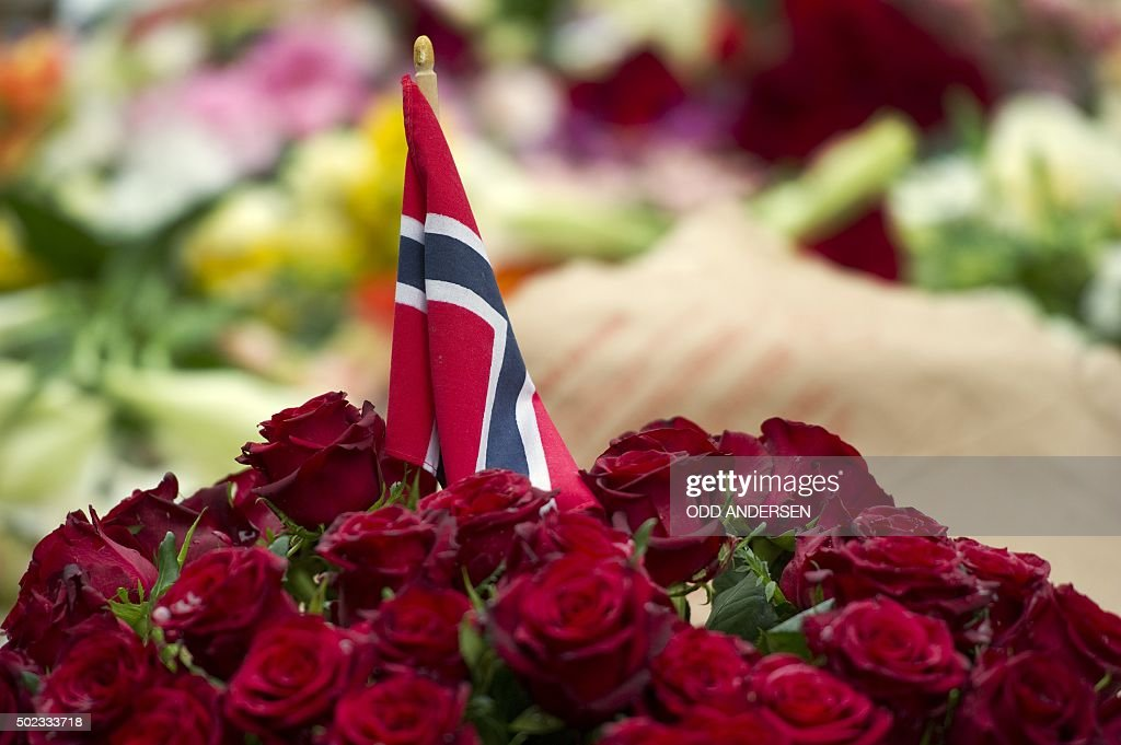 A Norwegian flag stands in a bunch of flowers during a gathering on July 24 2011 in Oslo to pay tribute to the victims of a bomb explosion which...