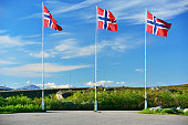 Norwegian flags on the Arctic Circle at Saltfjellet mountain area in Nordland county, Norway