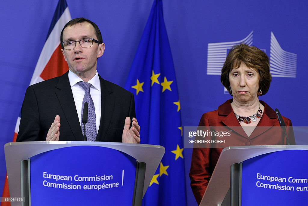 Norwegian Foreign Minister Espen Barth Eide (L) and High Representative of the European Union for Foreign Affairs and Security Policy Catherine Ashton (R) give a statement prior a meeting with Palestinian Prime Minister on March 19, 2013 at the EU Headquarters in Brussels. The meeting of the donor coordination group for the Palestinian people, the Ad Hoc Liaison Committee (AHLC) will focus on ways to address the deepening financial crisis of the PA, including strengthening its fiscal sustainability, improving the regularity and predictability of financial resources provided to the PA, increasing private sector-led growth, promoting access and movement throughout the Palestinian territory, facilitating Palestinian exports and improving the situation in the Gaza Strip . AFP PHOTO GEORGES GOBET