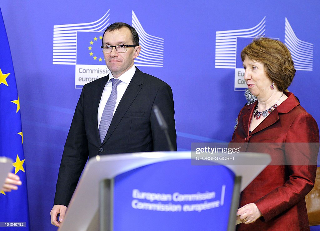 Norwegian Foreign Minister Espen Barth Eide (L) and High Representative of the European Union for Foreign Affairs and Security Policy Catherine Ashton (R) arrive to give a statement prior a meeting with Palestinian Prime Minister on March 19, 2013 at the EU Headquarters in Brussels. The meeting of the donor coordination group for the Palestinian people, the Ad Hoc Liaison Committee (AHLC) will focus on ways to address the deepening financial crisis of the PA, including strengthening its fiscal sustainability, improving the regularity and predictability of financial resources provided to the PA, increasing private sector-led growth, promoting access and movement throughout the Palestinian territory, facilitating Palestinian exports and improving the situation in the Gaza Strip . AFP PHOTO GEORGES GOBET