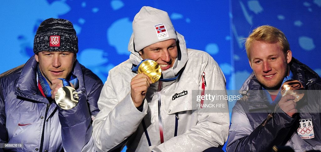 Norwegian gold medallist Aksel Lund Svindal (C), US silver medallist Bode Miller (L) and US bronze medallist Andrew Weibrecht (R) stand on the podium during the medal ceremony for the Alpine skiing Men's Super-G event of the Vancouver 2010 Winter Olympics at Whistler Medal Plaza venue on February 19, 2010 in Whistler.