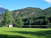 Norwegian house, a meadow in the sun