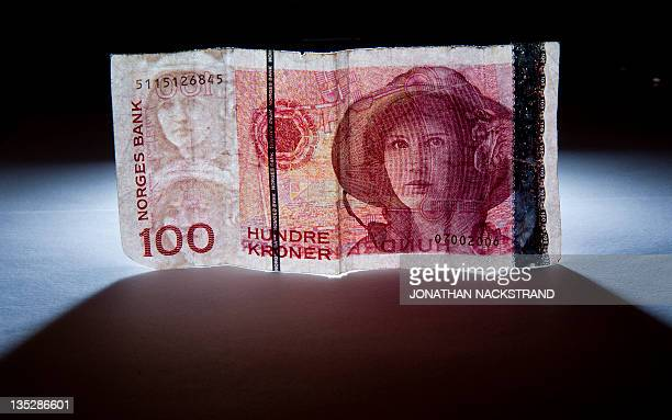 Norwegian hundred Crowns currency banknote pictured in Stockholm AFP PHOTO / JONATHAN NACKSTRAND