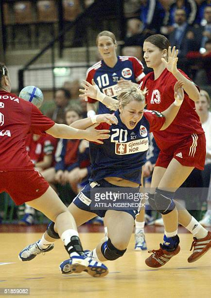 Norwegian Isabel Blanco is fouled by Russian defenders Ludmyla Postnova and Emilya Kurepta during a mainround match of the first group of 6th Women's...