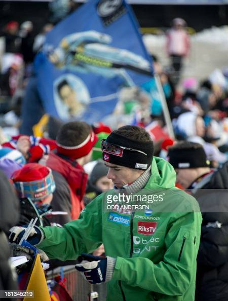 Norwegian jumper Anders Bardal write autographs to fans after the cancellation of the FIS Ski Jumping World Cup individual large hill competition on...