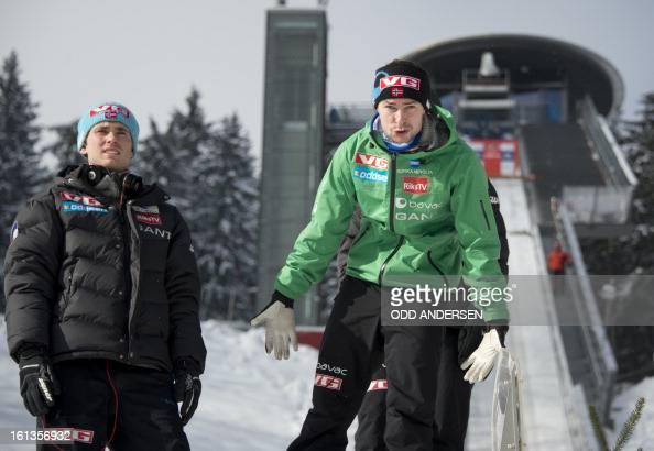 Norwegian jumper Anders Jacobsen reacts due to heavy wind as the start of the FIS Ski Jumping World Cup individual large hill competition has been...