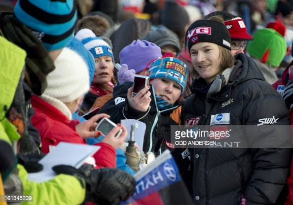 Norwegian jumper Tom Hilde writes autographs to fans after the cancellation of the FIS Ski Jumping World Cup individual large hill competition on the...