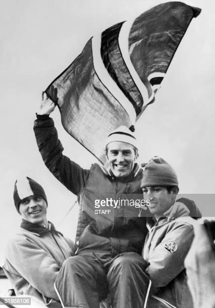Norwegian Magnar Solberg smiles as he is lifted by Swedish LarsGran Ardwison and East German Hansjrg Knauthe after winning the 20 km biathlon 09...