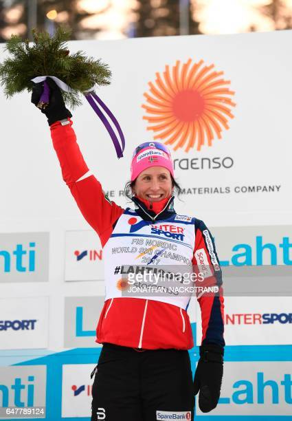 Norwegian Marit Bjoergen celebrates on the podium of the women 30 kilometers mass start free style competition of the 2017 FIS Nordic World Ski...