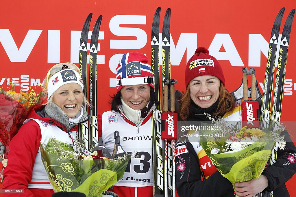 Norwegian Marit Bjoergen (C), Norwegian Therese Johaug (L ) and Pole Lustyna Kowalczyk (third) celebrate on the podium after the women's World Cup nordic skiing cross country 10km Mass Start, on January 19, 2013 in La Clusaz, south of France. AFP PHOTO / Jean Pierre Clatot