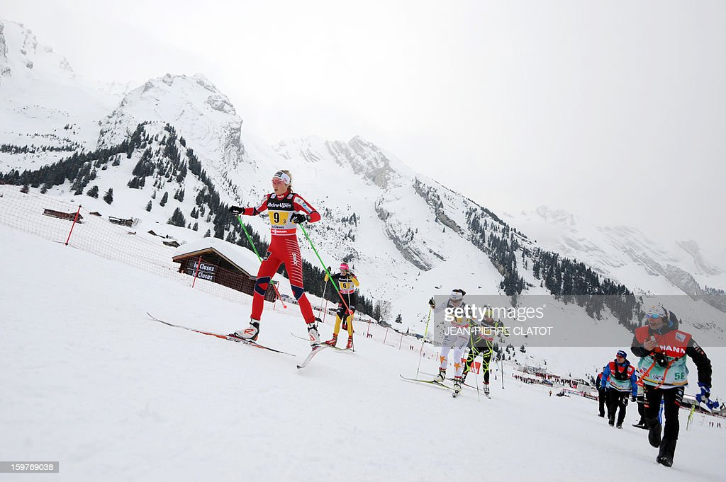 Norwegian Martine Ek Hagen (L) competes in the Ladies's Nordic skiing combined World Cup relay (4 x 5 km) on January 20, 2013 in La Clusaz, eastern France.