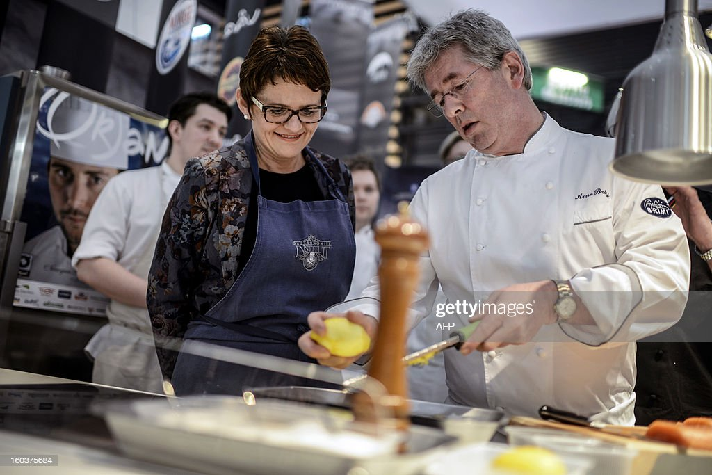 Norwegian Minister of Fisheries and Coastal Affairs, Lisbeth Berg-Hansen, cooks in the Norway stand, on January 30, 2013 in Chassieu during the SIRHA, central eastern France.