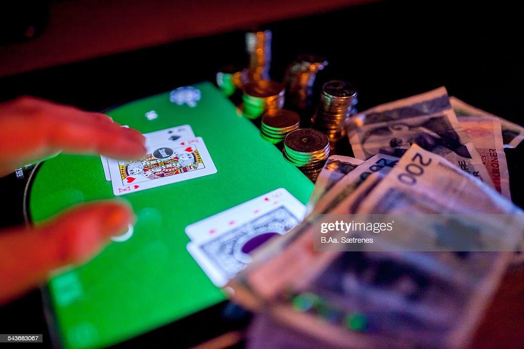Norwegian money and a digital tablet. The norwegian currency is called kroner (kr).