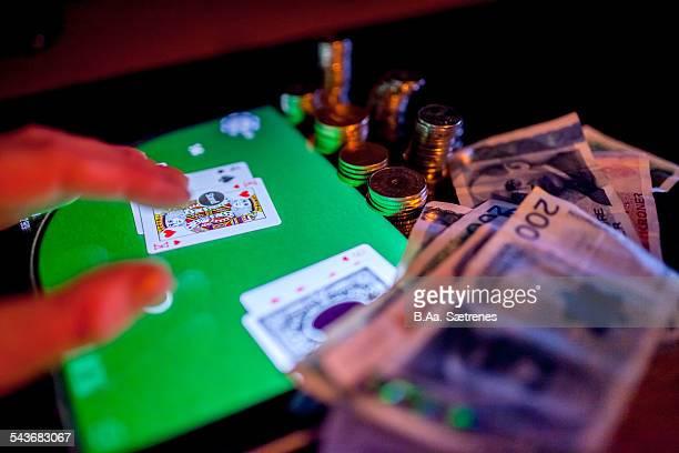 Norwegian money and a digital tablet The norwegian currency is called kroner