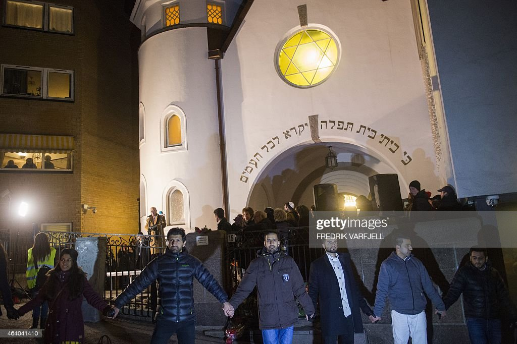 Norwegian Muslims create a human peace ring around the synagogue in Oslo Norway on February 21 2015 More than a 1000 joined a peace vigil in Oslo...