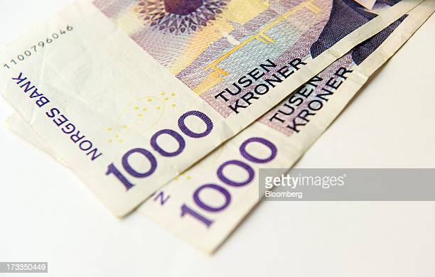 Norwegian one thousand krone currency notes sit in this arranged photograph in Oslo Norway on Friday July 13 2013 Norway's underlying inflation rate...