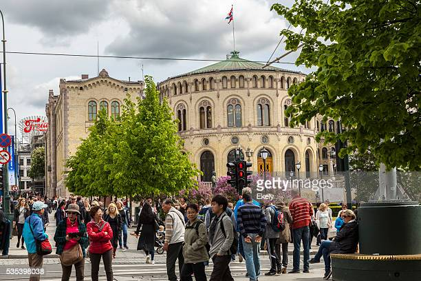 Norwegian parliament bulding with flag on roof in early May.