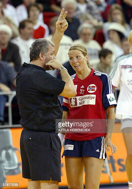 Norwegian player Gro Hammerseng gets a twominutes penalty by Slovakian referee Jan Beno during a semifinal match at 6th Women's European Handball...