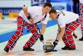 Norwegian players in action against Sweden in the final match of the world men's curling championship in Beijing on April 6 2014 Norway beat Sweden...