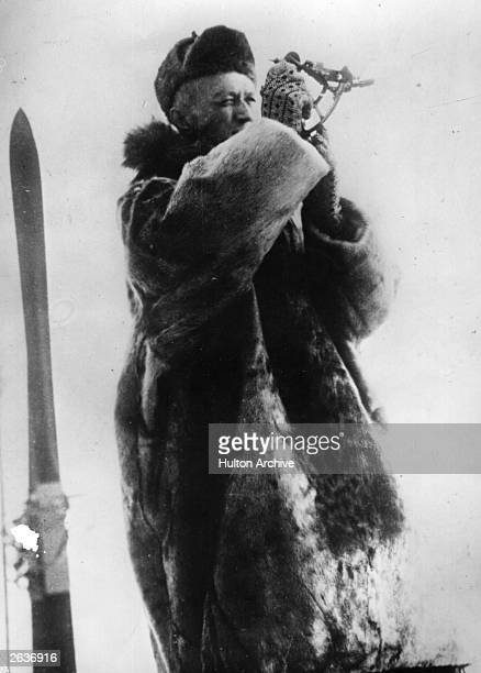 Norwegian Polar explorer Captain Roald Amundsen taking a bearing from the sun
