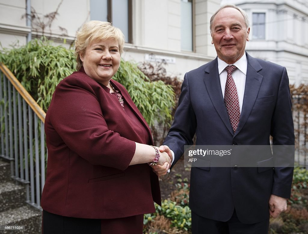 Norwegian Prime Minister <a gi-track='captionPersonalityLinkClicked' href=/galleries/search?phrase=Erna+Solberg&family=editorial&specificpeople=6165203 ng-click='$event.stopPropagation()'>Erna Solberg</a> (L)shakes hands with Latvian President Andris Berzins in front of her residence in Oslo, on March 18, 2015. AFP PHOTO / NTB scanpix / JUNGE, HEIKO NORWAY OUT
