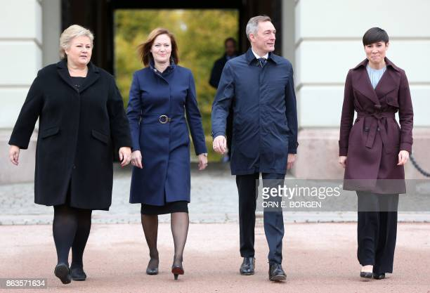 Norwegian Prime Minister Erna Solberg walks with newlyappointed Minister for EEA and EU Affairs Marit Berger Rosland Minister of Defence Frank...