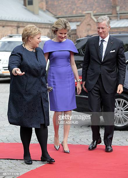 Norwegian Prime Minister Erna Solberg welcomes Belgian King Philippe and Queen Mathilde upon their arrival for a meeting in Oslo on April 30 2014...