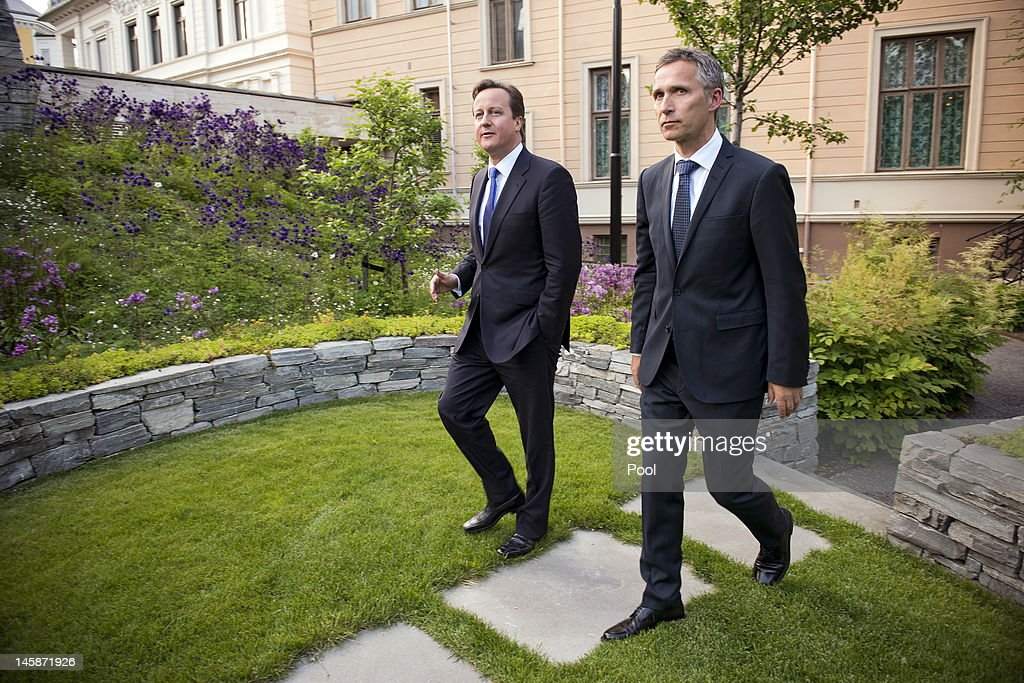 Norwegian Prime Minister <a gi-track='captionPersonalityLinkClicked' href=/galleries/search?phrase=Jens+Stoltenberg&family=editorial&specificpeople=558620 ng-click='$event.stopPropagation()'>Jens Stoltenberg</a> (R) and his British colleague <a gi-track='captionPersonalityLinkClicked' href=/galleries/search?phrase=David+Cameron+-+Politician&family=editorial&specificpeople=227076 ng-click='$event.stopPropagation()'>David Cameron</a> arrive for a press briefing in the garden of the Norwegian Prime Minister's residence on June 7, 2012 in Oslo, Norway. <a gi-track='captionPersonalityLinkClicked' href=/galleries/search?phrase=David+Cameron+-+Politician&family=editorial&specificpeople=227076 ng-click='$event.stopPropagation()'>David Cameron</a> became the first British Prime Minister in 26 years to visit Norway, the purpose of which being to establish a joint business advisory group aimed at 'ensuring a secure, affordable energy supply for the United Kingdom for decades to come'.
