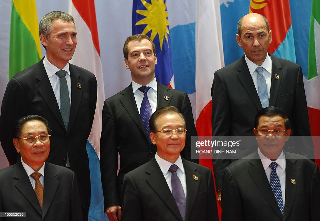 Norwegian Prime Minister Jens Stoltenberg, Russian Prime Minister Dmitri Medvedev, Slovenian Prime Minister Janez Jansa, (L-R bottom) Lao President Choummaly Sayasone, Chinese Prime Minister Wen Jiabao and Cambodian Prime Minister Hun Sen pose for a group photo prior to the opening ceremony of the ninth Asia-Europe (ASEM 9) summit in Vientiane on November 5, 2012. Dozens of European and Asian leaders will gather in impoverished Laos on November 5 for a major summit set to be dominated by the eurozone debt crisis and growing territorial tensions in the region. AFP PHOTO/HOANG DINH Nam