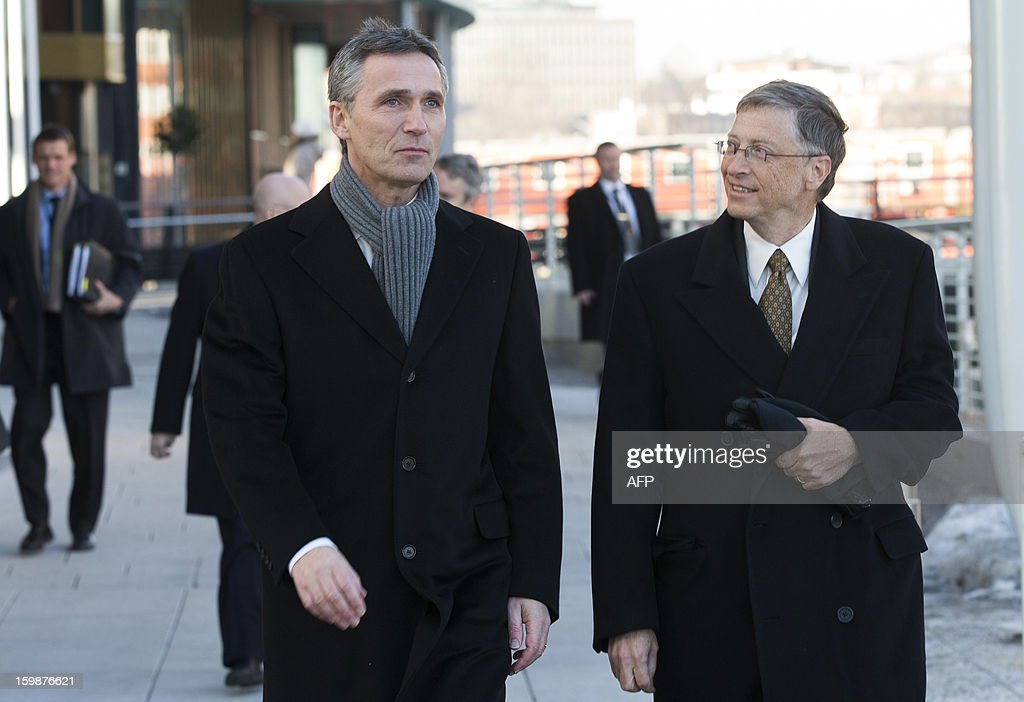 Norwegian Prime Minister Jens Stoltenberg (L) speaks with Bill Gates in Oslo on January 22, 2012. Stoltenberg and Gates attended a seminar which discussed challenges of international aid and health.