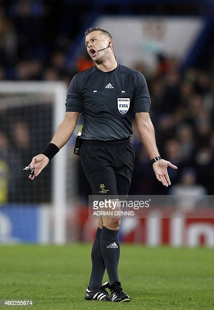 Norwegian referee Svein Oddvar Moen is pictured during the UEFA Champions League group G football match at Stamford Bridge in London on December 10...