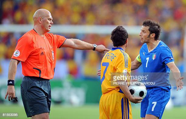 Norwegian referee Tom Henning talks to Italian forward Alessandro Del Piero next to Romanian mildfielder Florentin Petre during the Euro 2008...
