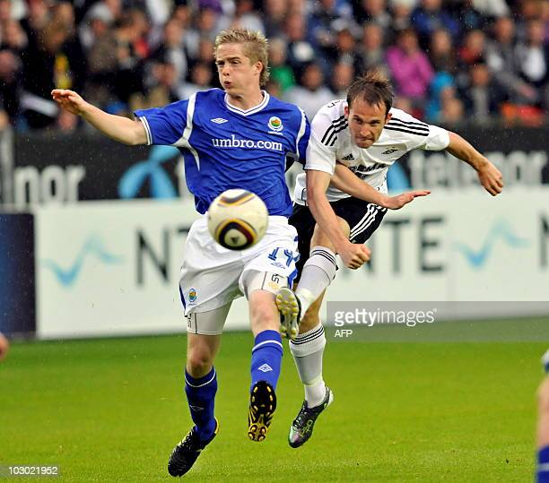 Norwegian Rosenborg BK Morten Moldskred vies for the ball with Aaron Burns of Linfield FC of Northern Ireland during the second round of the UEFA...