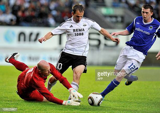 Norwegian Rosenborg BK Morten Moldskred vies with goalkeeper Alana Blayney of Linfield FC from Northern Ireland and Billy Joe Burns during the UEFA...