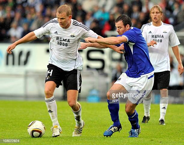 Norwegian Rosenborg BK Steffen Iversen plays for the ball with Linfield FC of Northern Ireland's Damien Curran during the second round of the UEFA...