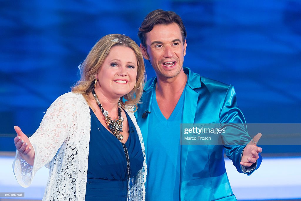 Norwegian singer Anita Hegerland (L) and German TV presenter <a gi-track='captionPersonalityLinkClicked' href=/galleries/search?phrase=Florian+Silbereisen&family=editorial&specificpeople=2919730 ng-click='$event.stopPropagation()'>Florian Silbereisen</a> (R) perform on stage during the 'Winterfest der fliegenden Stars' TV-Show on January 26, 2013 at the Freiheitshalle in in Hof, Germany.