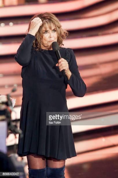 Norwegian singer Wencke Myhre performs during the tv show 'Willkommen bei Carmen Nebel' at TUI Arena on September 30 2017 in Hanover Germany