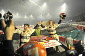 Norwegian skier Ole Einar Bjoerndalen celebrates after taking part in a rally with Norwegian driver Petter Solberg as his copilot during the Extreme...