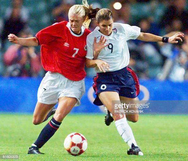 Norwegian Solveig Gulbrandsen fights for the ball with Mia Hamm of the United States in their women's soccer gold medal final at Sydney 2000 Olympic...