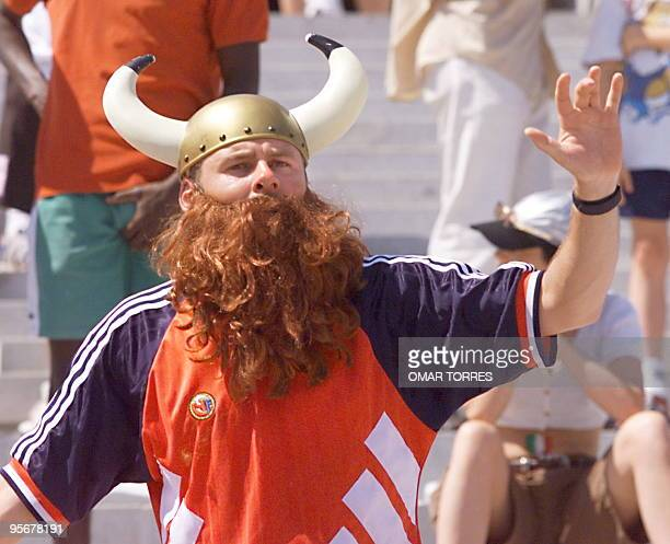 A Norwegian supporter dressed like a Viking chants slogans in support of his team on the stands of Stade Velodrome in Marseille south of France 27...